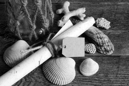 Seashells and glass jar with tag.