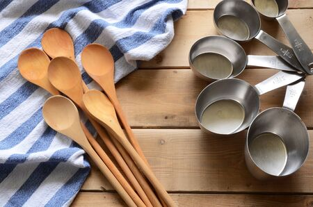 measuring cup: Wooden Mixing Spoons and Blue Dish Towel Stock Photo