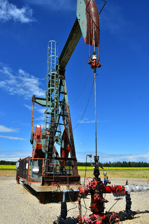 Working Oil and Gas Pumpjack Stock Photo