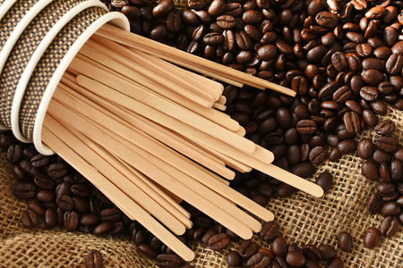 Wooden Stir Sticks and Coffee Beans 스톡 콘텐츠