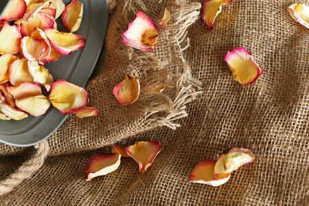 Dried Rose Petals and Old Burlap Fabric Stok Fotoğraf