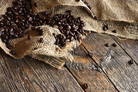Dark Roasted Coffee Beans and Burlap Cloth