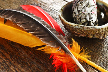 A close up image of colorful sacred feathers and white sage. 版權商用圖片