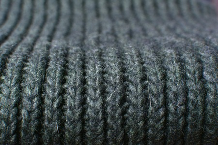 Large binding needles. Wool knitted fabric. Wool textiles. Crochet. Scarf. Background. Imagens