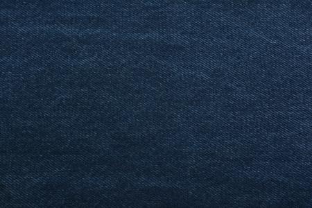 Texture of blue denim. Dense tissue. Textiles background Imagens