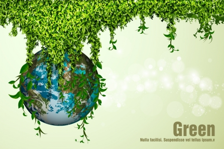 earth day: blue planet in the grass and leaves