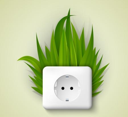 ecologic: Socket verde con la hierba del concepto de energ�a limpia