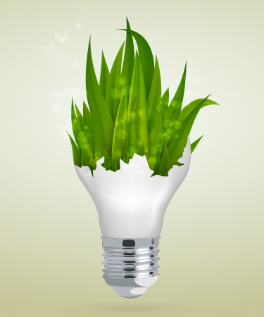 energysaving: grass in energy-saving light bulb with a glare  concept of clean energy