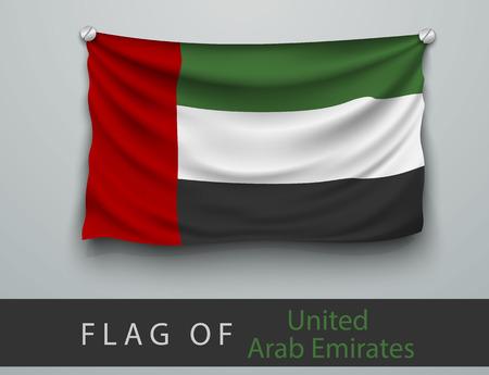 national: Bandera de los Emiratos Árabes Unidos golpeada, colgada en la pared, tornillos atornillados
