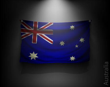 flagstaff: waving flag australia on a dark wall with a spotlight, illuminated