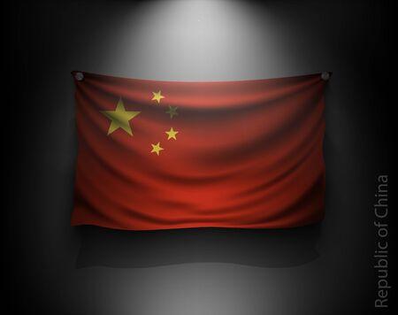 china wall: agitando bandera de la República de China en una pared oscura con un foco de luz, sistema de iluminación