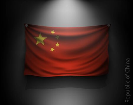 chinese flag: waving flag Chinese Republic on a dark wall with a spotlight, illuminated