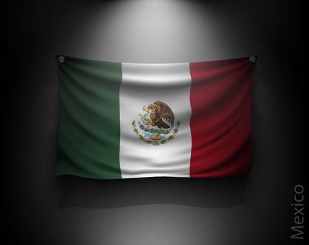 mexico flag: waving flag mexico on a dark wall with a spotlight, illuminated