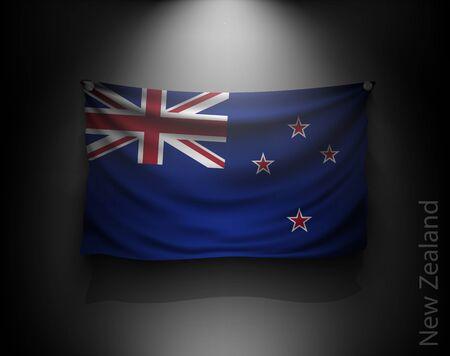 bandera de nueva zelanda: ondeando la bandera de Nueva Zelanda en una pared oscura con un foco de luz, sistema de iluminación
