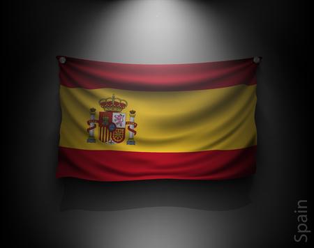 flag spain: waving flag spain on a dark wall with a spotlight, illuminated