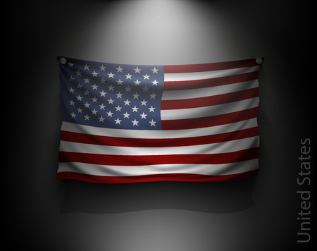 usa flags: waving flag United States on a dark wall with a spotlight, illuminated