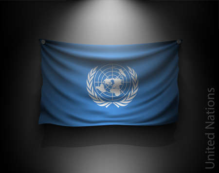 security council: waving flag United Nations on a dark wall with a spotlight, illuminated