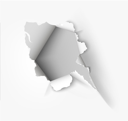 Hole torn in ripped paper on white background