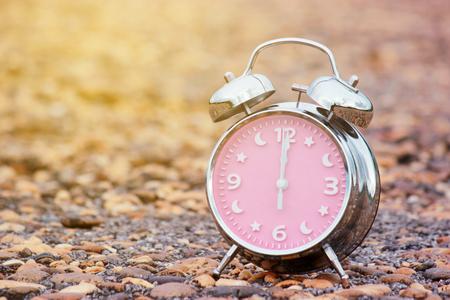 alarm clock on stone background
