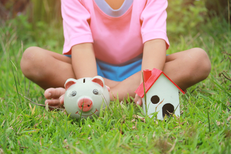 Asian kid, Save money set by childrens hands put coins.Concept of saving money for Future, soft focus.