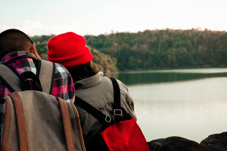 Two Kids Hiking With Backpacks Walking Studying The Route Map