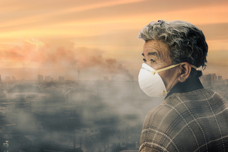 old woman wearing face mask because of air pollution in the city has a health effect. Ecology, Environmental awareness and virus protection concept, healthcare concept