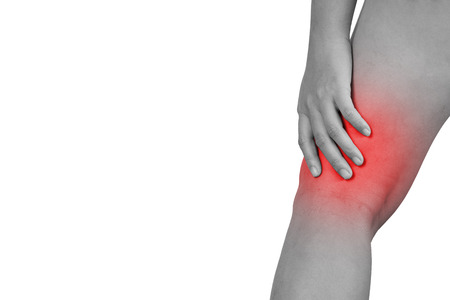 Inflammation colored in red suffering injured leg, healthcare and problem concept - isolated on white background with clipping path. 스톡 콘텐츠