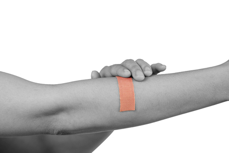 Hand women with adhesive plaster that covering a slight injury - isolated on white background with clipping path. Stock Photo