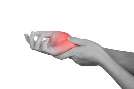 Acute pain in a wrist. healthcare and problem concept - isolated on white background with clipping path. Standard-Bild