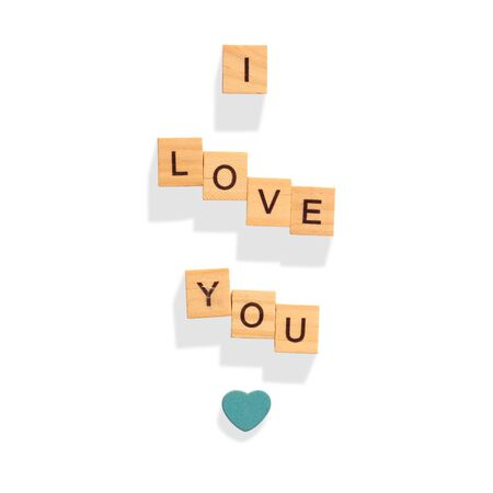 The words I LOVE YOU made with wooden letters, love and Valentines day, heart symbol. solated on white background with clipping path. Banco de Imagens