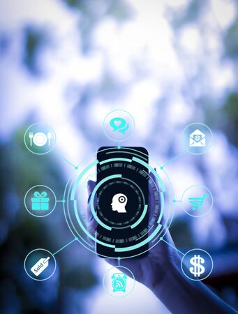 Business Women use smart phone technology with Internet of things futuristic concept. One finger click on digital screen. free space for text. Blurred gentle artistic nature background