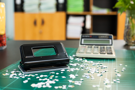 paper punch: Paper punch on work table in office Stock Photo