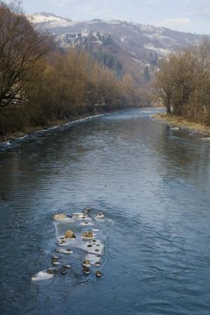 Carpathian mountains and Chorna Tisa river in winter, Ukraine Stock Photo