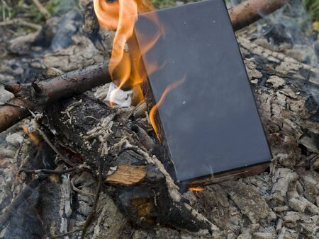 Black boxbook burning in a fire
