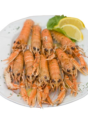 langouste: Big plate with cooked langouste facing the camera. Close view.