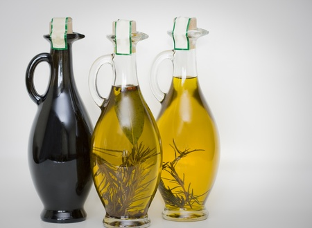 Three bottles of pure fresh olive oil isolated on white