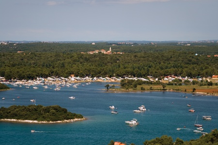 View on harbor, camping, Funtana village, island and luxury yachts from Vrsar city bell tower