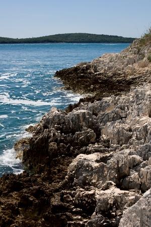 nudist: Rocky beach at famous nudist resort Koversada, Croatia