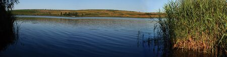 Panoramic lake and rush in Moldova photo