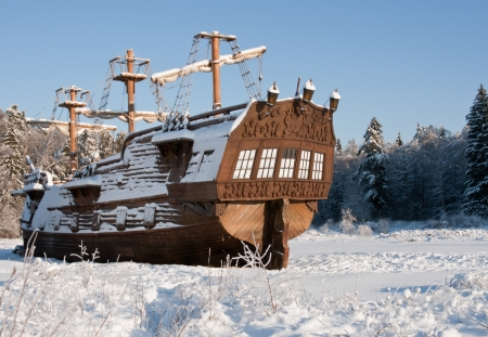 Vintage sail ship stern snow covered on a sunny day