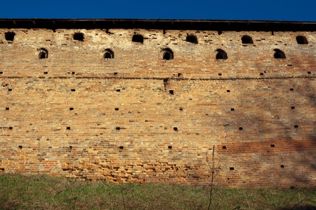loopholes: Brick wall with loopholes. Medieval castle. Stock Photo