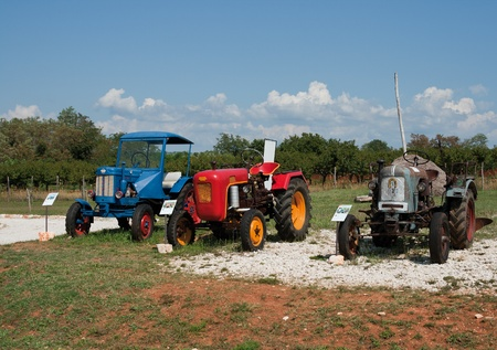 old tractors: Nova Vas, Croatia - August 02: Stihl, Eicher and Hanomag antique tractors on display at The Exhibition Of Old Tractors And Display Of Items About Bread, Oil And Wine.