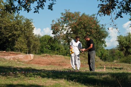 archaeologists: Cervar Porat, Croatia - August 05, 2011 - Two unidentified archaeologists do research in a Classical Roman Antiquity Lorun settlement of residential villa and ceramic workshop.  Editorial