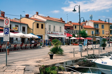 Novigrad, Croatia - August 08, 2011 - Seafront with restaurants and souvenir shops in old Istrian town. Town has retained its medieval structure and layout.  Stock Photo - 10808154