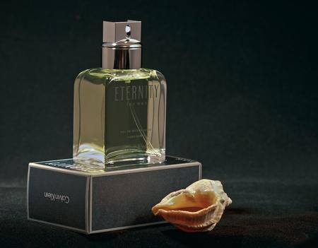 Kiev, Ukraine - February 15, 2011: Calvin Klein Eternity fragrance for men bottle and pack against black background.