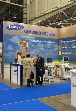 Kiev, Ukraine - October 13, 2011: Visitors visit Samsung booths during 20th International Exhibition PUBLIC HEALTH 2011 at International Exhibition Center in Kiev, Ukraine.
