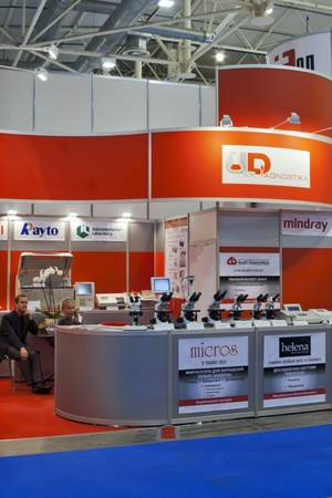 medical distribution: Kiev, Ukraine - October 13, 2011: UkrDiagnostika medical equipment distribution company booths at 20th International Exhibition PUBLIC HEALTH 2011 in International Exhibition Center. Editorial