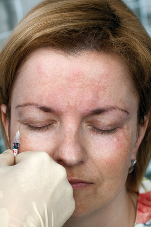 Botox injection in the eye, close up