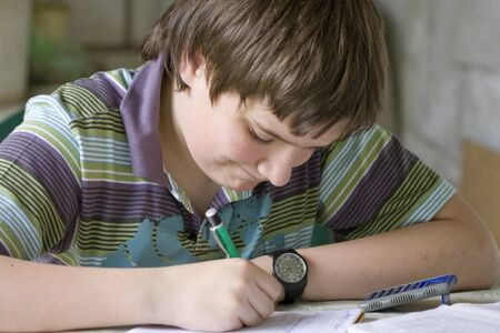 hardly: Writing boy hardly solving homework Stock Photo