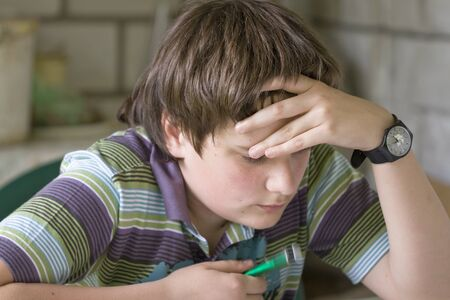 hardly: Thinking boy hardly solving homework